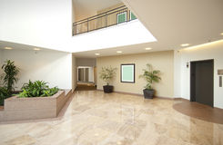 Entrance hall of business office. Office building entrance lobby in beige , white and marble Royalty Free Stock Image