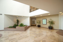Entrance hall of business office. Office building entrance lobby in beige , white and marble Royalty Free Stock Images