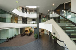 Entrance hall of business office. With balconies, staircase and green glass Royalty Free Stock Photo