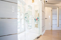 Entrance hall. Photo of big exclusive entrance hall with glass door Royalty Free Stock Image