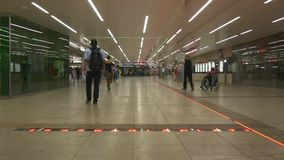 Entrance hall of underground metro station. VIENNA, AUSTRIA - AUGUST 2016: Entrance of underground metro station, a hall with stores, timetables and ticketing stock video footage