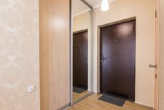 Entrance hallway, entrance door and built-in wardrobes royalty free stock photography