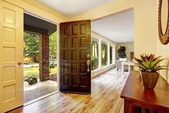 Entrance hallway with open door Stock Photos