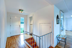 Entrance hallway with staircase in empty house Royalty Free Stock Photography