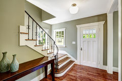 Entrance hallway with staircase royalty free stock photos