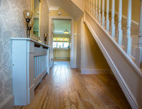 Entrance Hallway, Two Storey House. Entance hallway to a two storey house with timber floors Stock Image