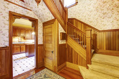 Entrance hallway with wooden staircase and beige carpet Royalty Free Stock Photography