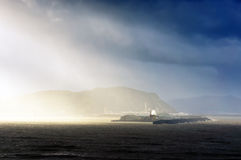 Entrance of harbour of bilbao with sun rays Stock Photography