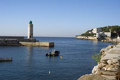 Entrance of the harbour of Cassis. France Stock Images