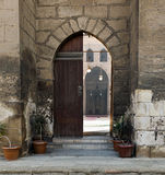 Entrance of a historic mosque, revealing the mosqu's courtyard Stock Photography