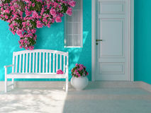 Entrance of a house. Front view of a wooden white door on a blue house with window. Beautiful roses and bench on the porch. Entrance of a house Royalty Free Stock Photography