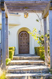 Entrance of a house over outdoor landscape Royalty Free Stock Photo