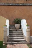 Entrance with stairs and flowers Royalty Free Stock Image