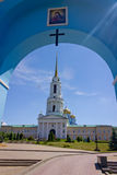 Entrance with the icon of the virgin Mary in the yard of the monastery. The city`s skyline. Stock Photo