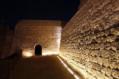 Entrance and illuminated wall at upper level of Bahrain fort Royalty Free Stock Photo