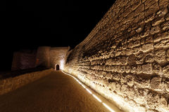 Entrance and illuminated walls of Bahrain fort Stock Photo
