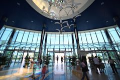 Entrance inside shopping center in Marina mall. ABU DHABI - APRIL 15: Entrance inside large shopping center in Marina mall on April 15, 2010 in Abu Dhabi, UAE Stock Photos