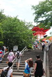 The entrance of Kiyomizu-Dera Temple in Kyoto crowded by visitors and tourists. Royalty Free Stock Photo