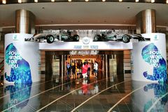 An entrance of KLCC shopping mall with the replica of Mercedes-AMG Petronas Motorsport F1 racing car. KUALA LUMPUR, MALAYSIA - APRIL 08, 2017: An entrance of Royalty Free Stock Photo