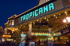 The entrance of legendary Tropicana Hotel and Casino glows brightly as evening sets in. stock images