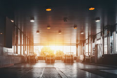 Entrance of mall or underground station. View from floor of entrance of underground metro station on daytime with several escalators moving up and down, striped Royalty Free Stock Image