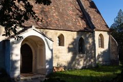 Small Medieval chapel entrance, windows royalty free stock image
