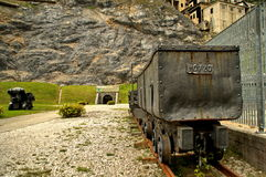 The entrance of the mine. A metal trolley at the entrance of an abandoned mine in the town of Cave del Predil on the Alpes of Northern Italy Stock Image
