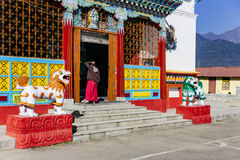 Entrance with monk of Tibetan Buddhism Temple in Sikkim, India.  Royalty Free Stock Photography
