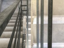 Entrance in a new building, steps, top view from the bottom. Construction of concrete stairs under construction works.  royalty free stock image