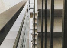 Entrance in a new building, steps, top view from the bottom. Construction of concrete stairs under construction works.  stock photos