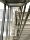 Entrance in a new building, steps, top view down. Construction of concrete stairs under construction works. Construction of concrete stairs under construction royalty free stock photo