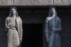 Entrance of Njegusi Mausoleum in Lovcen National Park framed by stone statues, Albania royalty free stock photo
