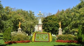 Entrance of Notre-Dame-des-Neiges Cemetery. MONTREAL CANADA OCTOBER 11 2015: Entrance of Notre-Dame-des-Neiges Cemetery with colorful autumn trees. Is the stock photos