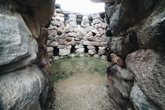 Entrance of Nuraghe Su Nuraxi in Barumini, Sardinia, Italy. View of archeological nuragic complex royalty free stock image