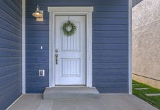 Free Entrance Of A Home With Blue Wall And White Door Royalty Free Stock Photography - 133652627