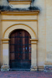 Entrance of old colonial building with wood door Royalty Free Stock Images