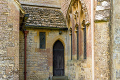 Entrance in an old English church. At the English churches are still preserved elements of the old knights time Stock Images