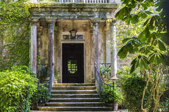 Entrance of an old mansion with garden Royalty Free Stock Photos