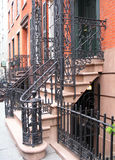 Entrance with ornate railings. Entrance to Greenwich Village, NYC townhouse with ornate wrought iron railings Stock Photo