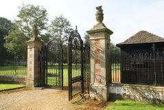 Entrance. ornate wrought iron gate with griffin statues Royalty Free Stock Photography