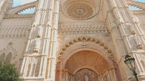 Entrance into Palma cathedral. With tree on left stock video footage