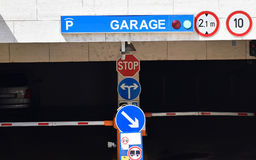 Entrance of the parking garage. With traffic signs Stock Image