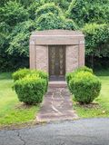 Entrance path to family mausoleum stock photos