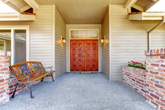 Entrance porch with antique bench Royalty Free Stock Images