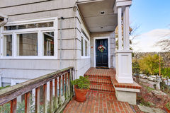 Entrance porch with black door Stock Photos