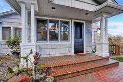 Entrance porch with black door. Entrance porch with brick tile floor and black door Stock Photos