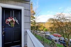 Entrance porch with black door Royalty Free Stock Photos