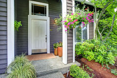 Entrance porch with blooming flowers Royalty Free Stock Photos
