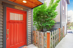 Entrance porch with bright red door Royalty Free Stock Photo