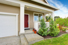 Entrance porch with front yard landscape royalty free stock photo